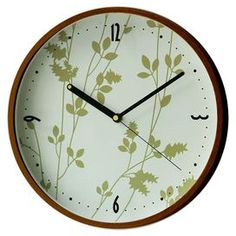 With its modern design and floral detailing, this gorgeous clock is the perfect complement to the light wood finishes, neutral palette and leafy green houseplants of your Asian scheme.  Product: Wall clockConstruction Material: Mahogany woodColour: Natural and multiFeatures: Analogue displayAccommodates: Batteries - not includedDimensions: 31 cm Diameter x 4 cm D