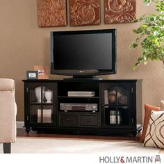 The Hanover black media cabinet has double glass doors for storage, open shelves for media equipment and a drawer for concealed storage. This media cabinet will accommodate up to a flat screen TV. Black Entertainment Centers, Contemporary Entertainment Center, Entertainment Ideas, Entertainment Products, Black Tv Console, Tv Stand Console, Console Cabinet, Rick Y, Media Cabinet