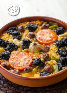 Typical Valencian rice dish - baked in oven, with local sausage, potato, garlic and tomato. Arroz al horno / arros al forn