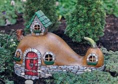 Fairy Garden Miniature Fiddlehead Fairy Crookneck Cottage. $29.99 Click here to purchase --> http://www.bakersvillagegardencenter.com/item_411/Fairy-Garden-Miniature-Fiddlehead-Fairy-Crookneck-Cottage.htm