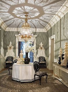 """Michelle modeled this grand chandelier after a Turkish lantern. She writes in Wanderlust, """"At the flick of a switch, light and shadow spill across the ceiling and over the walls in a fantastic filigree that transports you to the era of Scheherazade."""""""