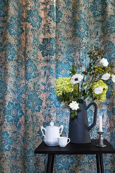 Mireval Fabric - This stylised flower and foliage design combines different techniques of print, appliqué and embroidery with a unique hand-made feel. Available at Fallon 4 Interiors Limited 01386 422222