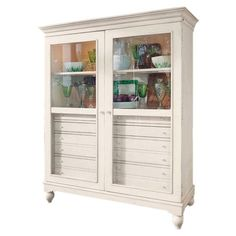 Showcase family heirlooms and curios in this lovely 2-door cabinet. 8 interior drawers stow linens, flatware, and more, while 2 lighted shelves highlight dec...