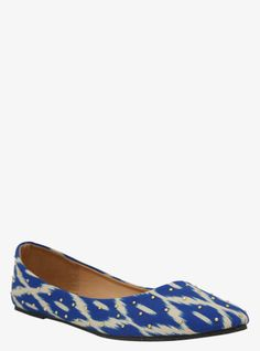 This super cute pair of flats will have you kicking off your heels. A blue and ivory ikat print mixes it up with gold tone studs for a slip-on that is destined for chic sun-ready looks.