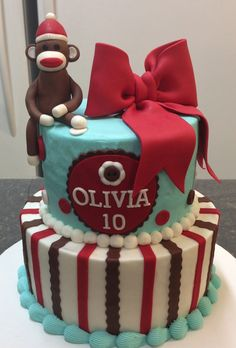 Sock Monkey Cake - like the 3d red bow and the mix - modern/retro;  simple/cool