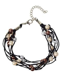Trades of Hope - Cambodia Pearl Bracelet - Faux pearl beads in three neutral hues tied on black cotton cord makes for an easy-to-wear, 6.5-inch-long bracelet with a 1.75-inch extender.
