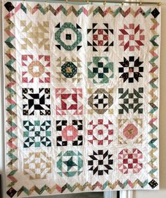 This would make a perfect crib quilt.  Sampler Quilt in pinks brown greens beiges and by GoodiesByJamie