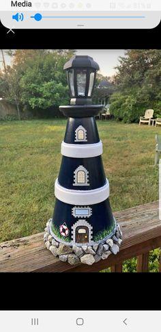 Flower Pot Art, Clay Flower Pots, Flower Pot Crafts, Clay Pot Lighthouse, Lighthouse Decor, Clay Pot Projects, Clay Pot Crafts, Painted Clay Pots, Painted Flower Pots