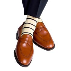 These yellow with navy stripe men's dress socks are made with an exceptionally soft mercerized cotton. Expertly knitted at a third-generation North Carolina mil