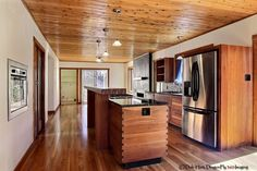 boxed in fridge, dovetailed island cladding, flush fitting drawers/cupboards. 414 Amherst Dr SE, Albuquerque, NM 87106