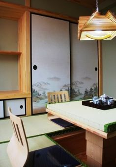 japanese interior design - a simple dining area with painted screening