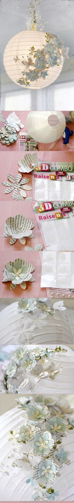 paper flowers decorate a round paper lantern