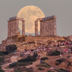Soúnion, Attiki, Greece.  Full moon over the   sanctuary of god Poseidon..  Feast of colors and light..❤❤ .