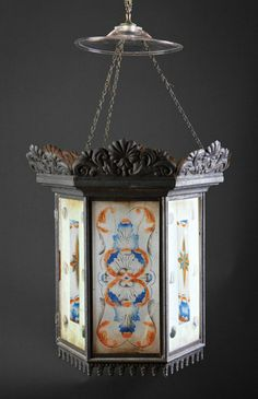 An American Tole and Eglomise Hall Lantern, 19th c., hexagonal form, fitted with acanthine and compass star decoration, height 24 in., diameter 9 1/2 in