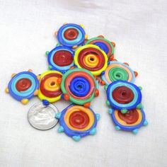 Lampwork glass disk beads - with bumps! These would make great earrings.