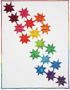 Grab your favorite batik fabrics and look to the stars for inspiration. This modern star quilt design looks fresh and crisp with colorful batik stars trail
