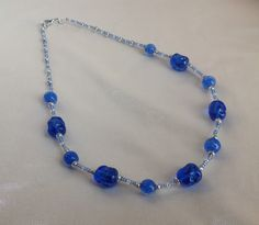 Collier blu-argento con perle irregolari : Collane di queen-dody-dreams
