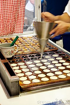 Traditional Dutch treat, resembling small, fluffy pancakes ~ Poffertjes