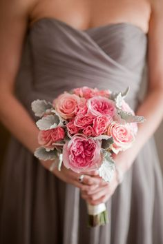 Pink garden roses and dusty miller. prettyyyy. my home page has a lot of wedding stuff on it today. I'm not sure why. But I always like grey as a central color for weddings. Specifically grey and yellow.