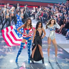 Singer Selena Gomez performs while models Taylor Hill (L) and Megan Puleri (R) walk the runway during the 2015 Victoria's Secret Fashion Show at Lexington Armory on November 10, 2015 in New York City.