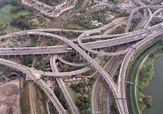 Gravelly Hill Interchange, the intersection of the M6 motorway, A38 motorway, A38 road and A5127 road above two railway lines, three canals and two rivers in Birmingham, England. Opened in May 1972, it is considered to be the first Spaghetti Junction.