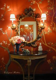 Sconces, gilt mirror and table vignette, Lynne Rutter's hand-painted Chinoiserie walls in autumn hues