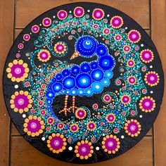 Peacock painted stepping stone by Rebecca Blake