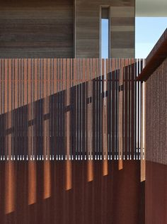 Great custom laser cut fence that is corroding nicely.    Bates Masi Architects have designed this house that sits between the Atlantic Ocean and a freshwater pond in Sagaponack, New York
