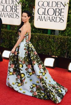 Lucy Liu in fantastic flowered-patterned straplees gown by Carolina Herrera