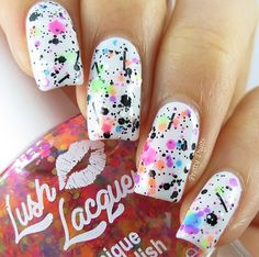"""lush lacquer """"clowning around"""" with b glitter over white"""