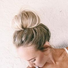 heres a look at how we do our signature messy top knot! what you'll need: -hair tie -bobby pins -comb Instructions: 1. start by teasing the front section of your hair around your face 2. comb through this hair with your fingers to get rid of huge lumps *TIP: we don't want this part to look smooth so some bumps are okay 3. pull hair into ponytail on top of your head *TIP: this is where your bun will end up so make it as high or low on your head as you'd like 4. pull out p...