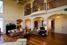 I love arched doorways.  The trimmed paneling is interesting and the balcony style walkway.  Wow--that ceiling!