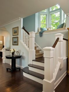 Wood and white stairs. Love round table by stairs. Have to do this in new house!