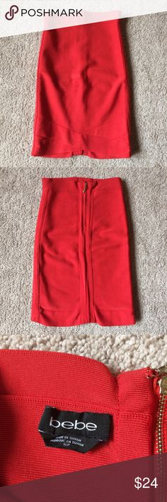 "Bebe fiery red bandage skirt Bebe fiery red bandage skirt. Criss cross design at the bottom. Gold back zipper. Waist 10.5"" across; length 18.5"". Perfect condition. Tag reads small, but would best fit XS/XXS. I apologize for the wrinkles in the pictures. bebe Skirts Mini"