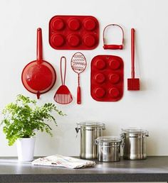 It's amazing what a little red spray paint and some cast off kitchen gadgets can become.