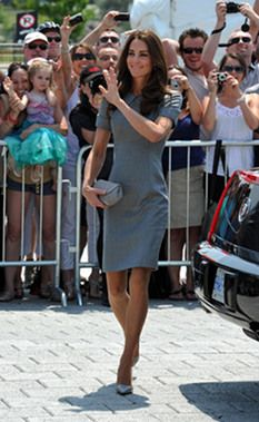 Kate was prim and proper in a subdued grey Catherine Walker dress. Catherine Walker was the designer of Kate's mom's wedding ensemble and a favorite of Princess Diana. This grey dress was paired with a matching Hobbs clutch and Tabitha Simmons pumps.