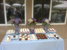 Cupcake display with hydrangea stuffed tubes.