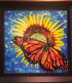 Stained glass mosaic monarch butterfly on a sunflower, courtesy of Kickin' Glass Kansas.