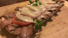 What to make for dinner when you have one leftover Rib Eye steak?...An open faced sandwich with a garlic and fresh herb butter! Oven roasted tomatoes, sauteed shallots, and provolone cheese finish this incredible leftover meal. Yuuuuuummmm...
