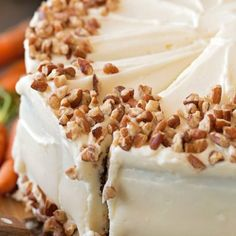 This classic carrot cake is moist, fluffy and spiced to perfection. It's topped with a thick cream cheese frosting and toasted pecans. Perfect for spring! Classic Carrot Cake Recipe, Best Carrot Cake, Carrot Cakes, Carrot Cake Cheesecake, Cheesecake Bars, Toasted Pecans, Moist Cakes, Savoury Cake, Clean Eating Snacks