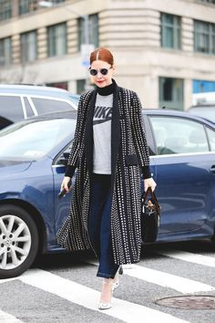 New Ways To Wear Clothes You Were About To Retire #refinery29  http://www.refinery29.com/unexpected-street-style-styling-tips#slide-11  Dress up a worn-in, sporty logo tee with a black turtleneck underneath and a statement coat on top....