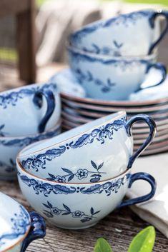 Pleasant summer weather beckons outdoor dining, where Clementine sets a table with some of her favorite blue-and-white crockery.