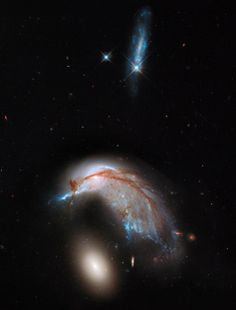 Colliding Galaxy Pair | NASA | This interacting galaxy duo is collectively called Arp 142. The pair contains the disturbed, star-forming spiral galaxy NGC 2936, along with its elliptical companion, NGC 2937 at lower left.