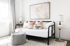 Pink and black guest room features a pink and gold abstract art piece placed ove. - Pink and black guest room features a pink and gold abstract art piece placed over a black daybed dr - Daybed Pillows, Daybed Room, Pink Pillows, Daybed Pillow Arrangement, Black Daybed, Ideas Habitaciones, Metal Daybed, Plywood Furniture, Pink Bedroom For Girls