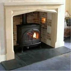 We remove, renovate and install antique fireplace mantels, inserts and hearths to create beautiful period fireplaces integrated with wood burning stoves in Essex and London Wood, Cottage Fireplace, Wood Stove, Coffee Table Furniture Design, Fireplace Heat, Wood Mantels, Woodburning Stove Fireplace, Fireplace, Slate Hearth