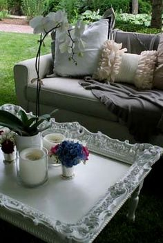Take an Old picture frame... secure it on top of an old or plain coffee table...., paint ALL the same colour and you now have a lovely and unique coffee table for inside of the house .or in your backyard patio. - LARGE PHOTO.