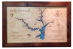 Lake Hartwell, Georgia: Framed Wood Map Wall Hanging. This is a beautifully detailed, laser engraved and precision cut topographical Map of Lake Hartwell, bordering Georgia and South Carolina with the following interesting stats carved into it: Lake Hartwell, Hart County, Hartwell GA All named after Nancy Hart due to her heroic exploits on behalf of the Patriots cause during the revolutionary war. Constructed: 1955 - 1959 Surface area: 56,000 acres Shoreline: 962 miles Depth behind dam…