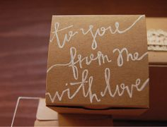 Creative: Eleven Simple Ways To Gift Wrap  (Make it personal: DIY hand lettered gift wrap Via The Sweetest Occasion)