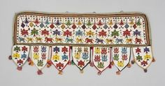 Hanging Local Name: 	toran Place Made: 	Asia: South Asia, India, Western India, Gujarat, Saurashtra Period: 	Mid 20th century Date: 	1940 - 1960 Dimensions: 	L 100 cm x W 42 cm Materials: 	Glass bead; cotton Techniques: 	Beadwork; tasseled; machine-sewn