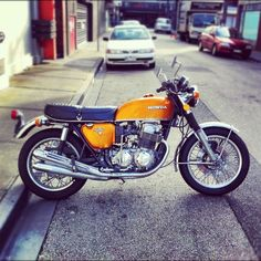 Lovin this old Honda. The orange really suits it.: